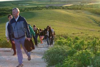 hiking up hill at Konza